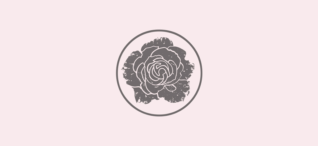 The logo of The Southern Rose, which is a gray rose inside of a gray ring on a pale pink background.
